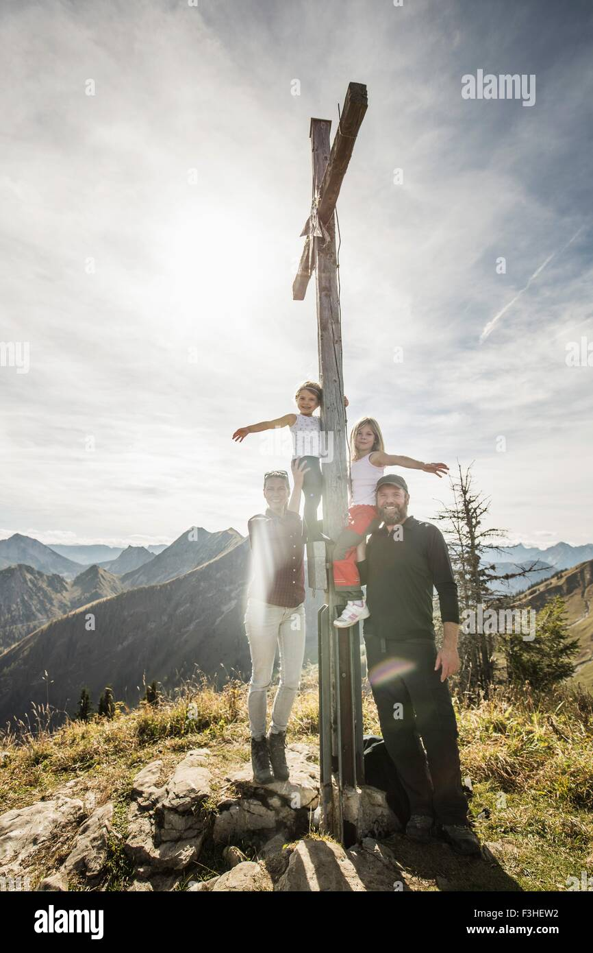 Portrait of couple with two daughters at religious cross, Achenkirch, Austria - Stock Image