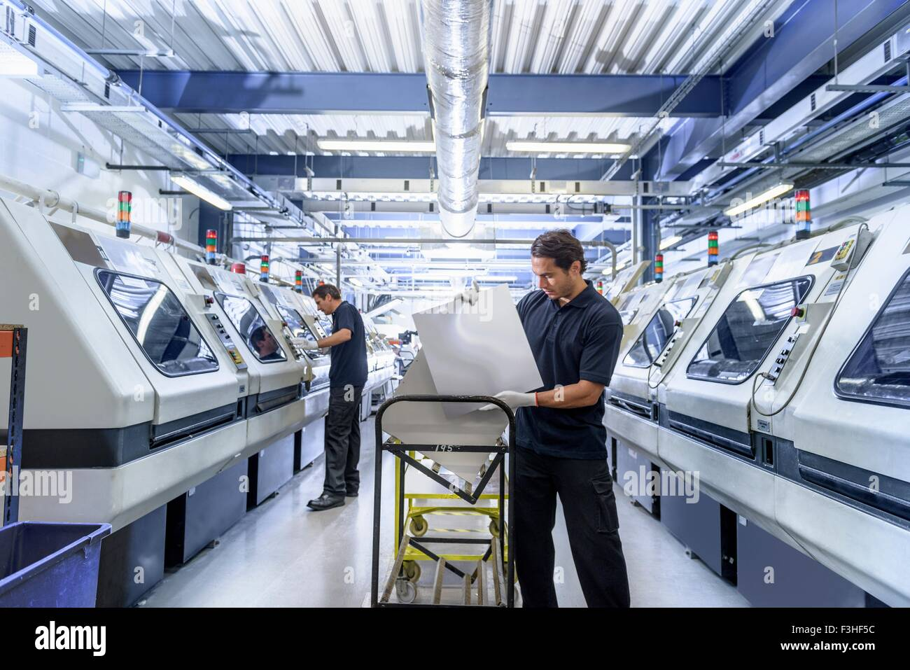 Workers in circuit board manufacturing factory - Stock Image