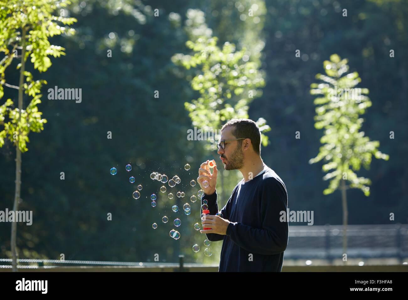 Man blowing bubbles, Valle de Aran, Spain - Stock Image