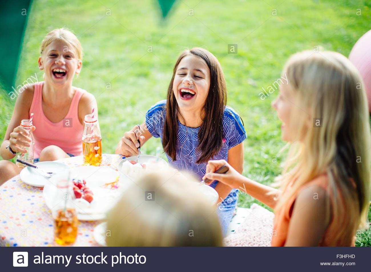 Girls having fun at summer garden party - Stock Image