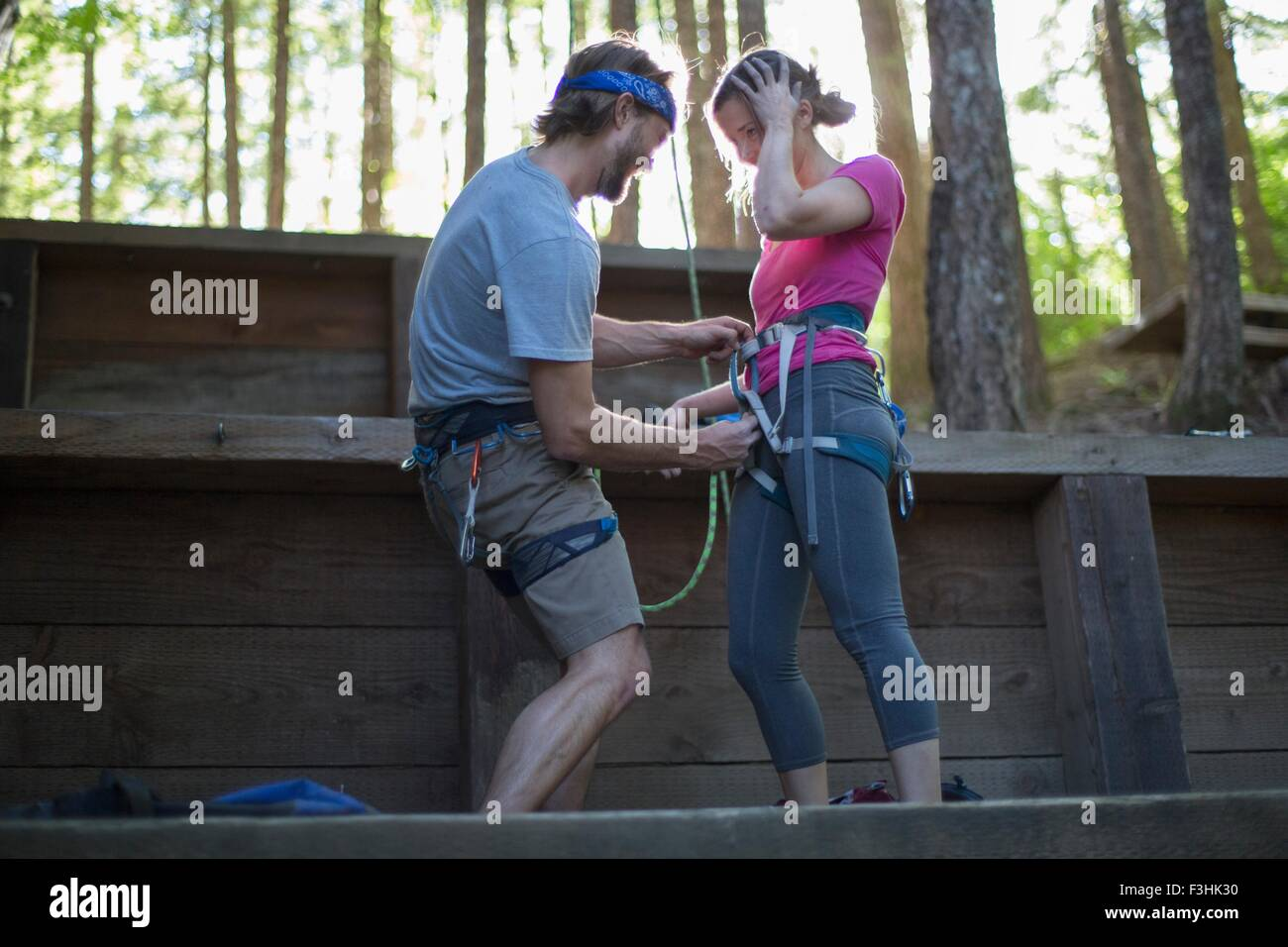 Couple preparing for rock climbing, French's Dome, Zig Zag, Oregon, USA - Stock Image