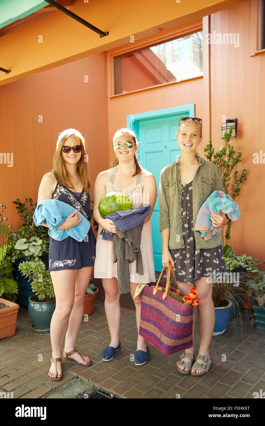 Girls with towels going to party - Stock Image