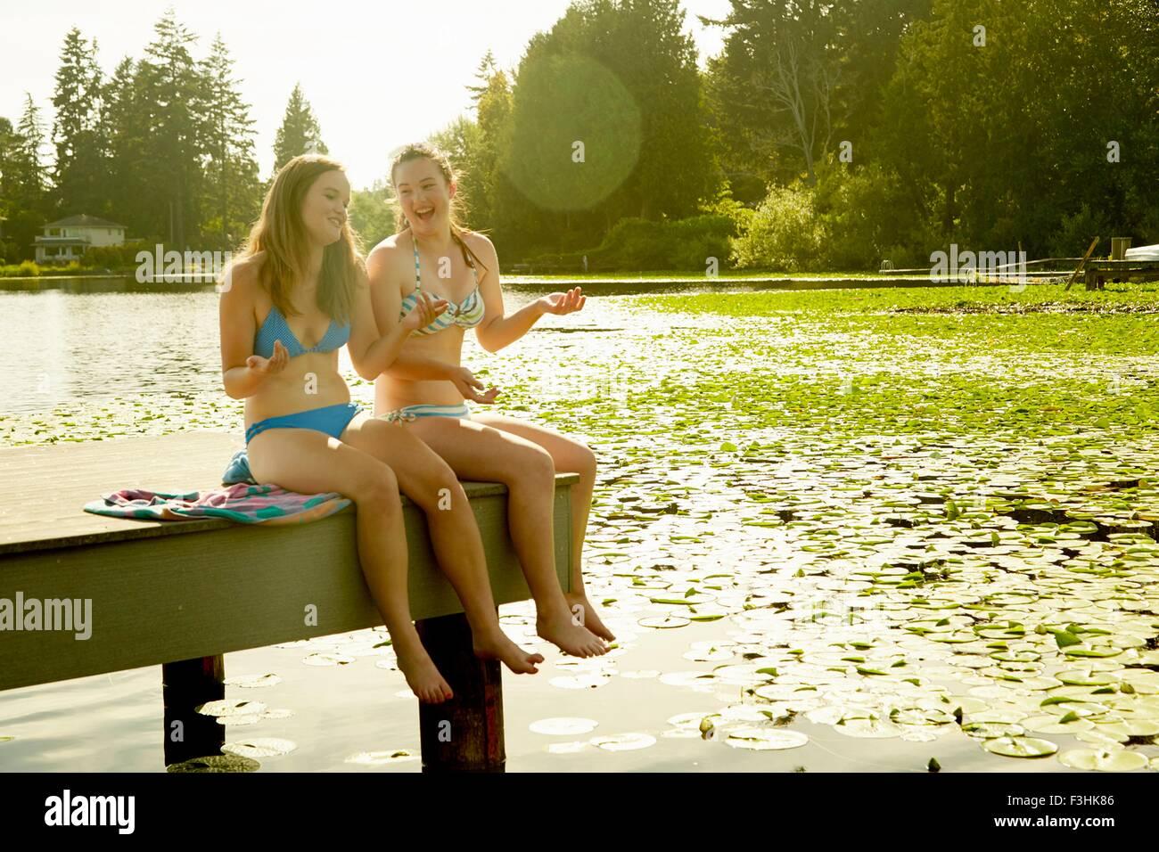 Girls in bikini enjoying lake, Seattle, Washington, USA - Stock Image