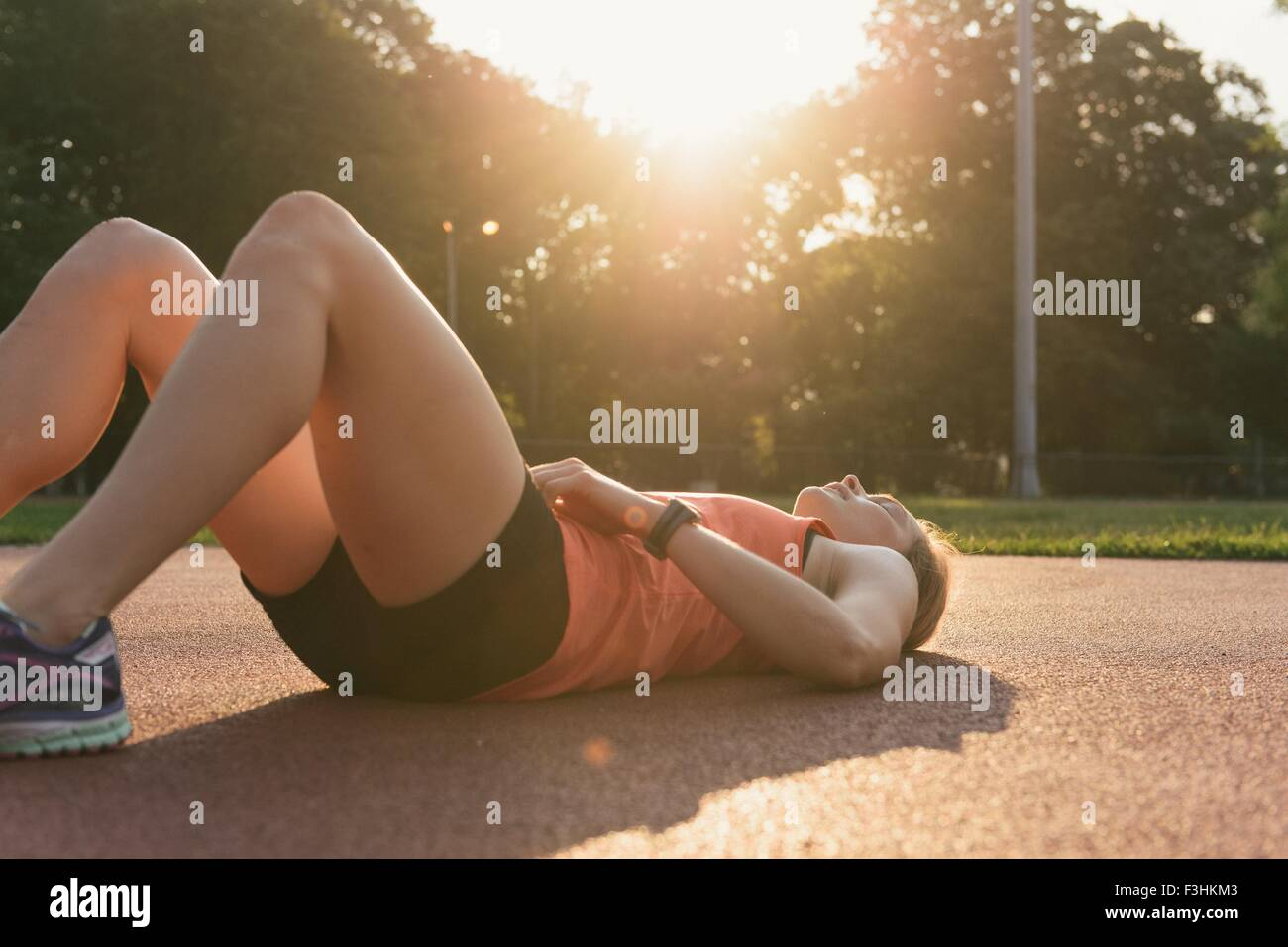 Young woman working out, outdoors - Stock Image