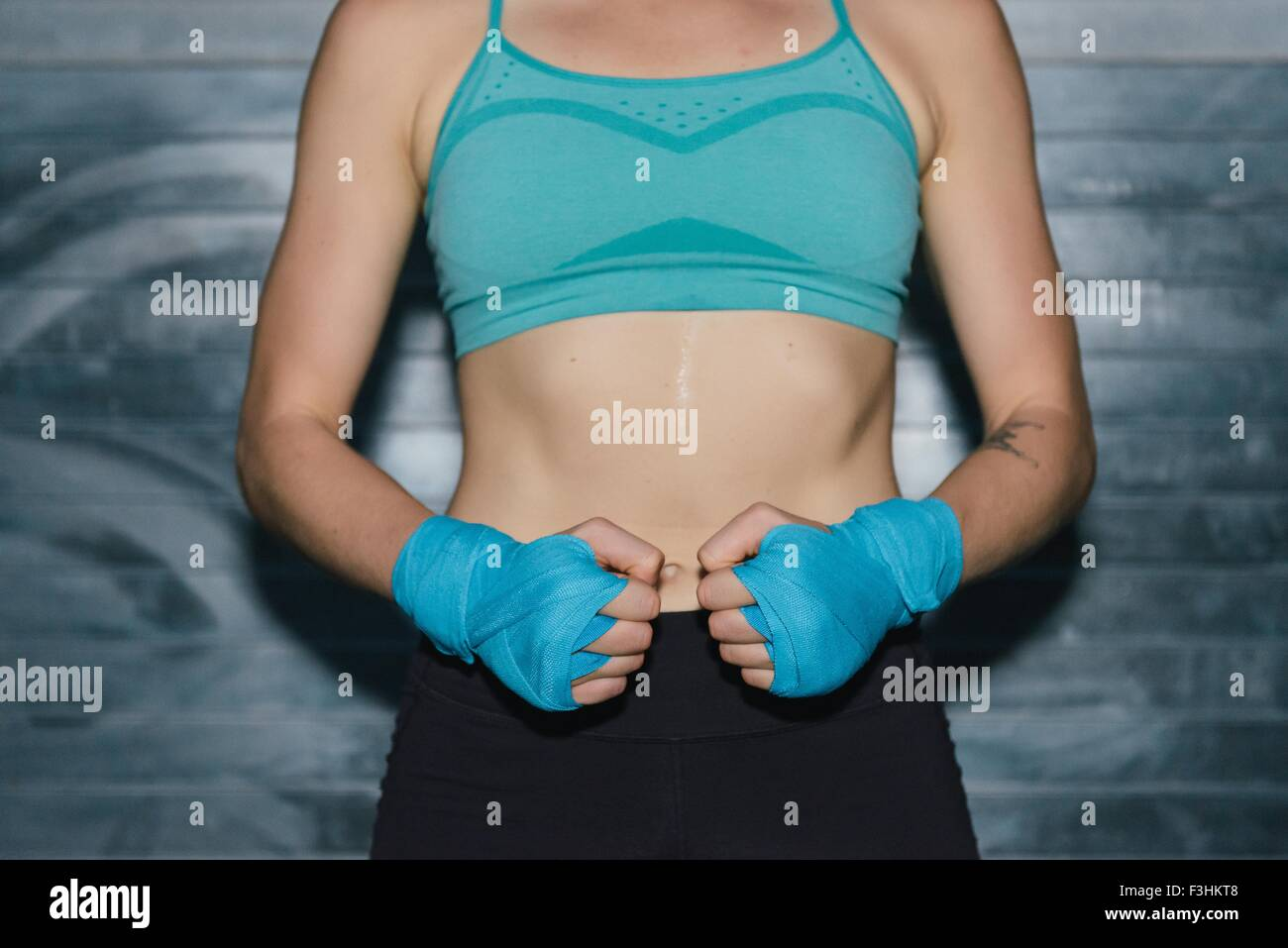 Young woman wearing sports clothing, mid section Stock Photo