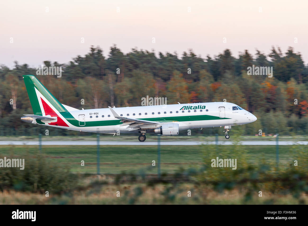 Alitalia Embraer 170 at the runway of Frankfurt International Airport - Stock Image