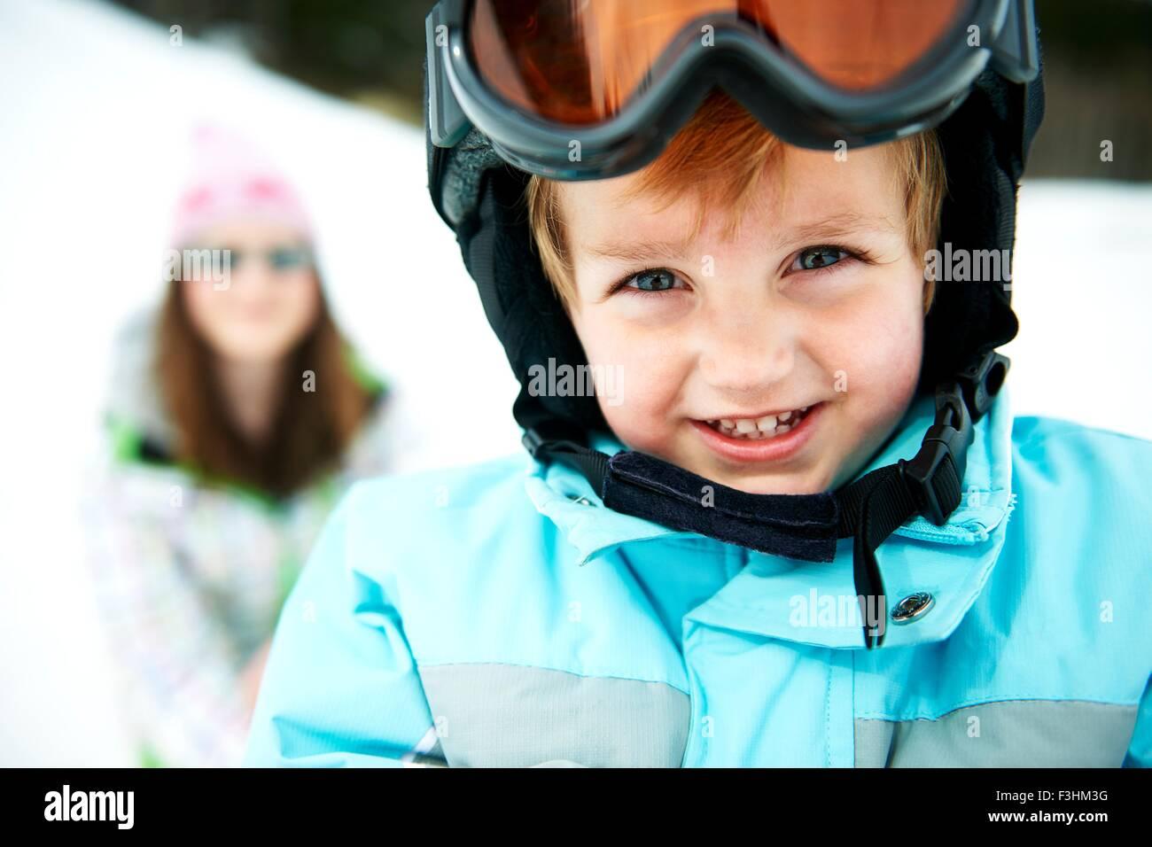 Portrait of male toddler wearing ski helmet - Stock Image