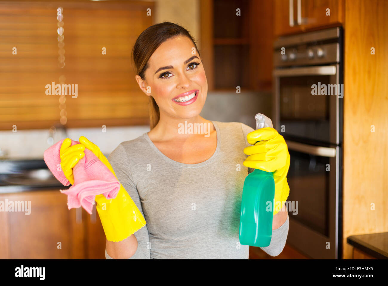 portrait of pretty woman doing housework - Stock Image