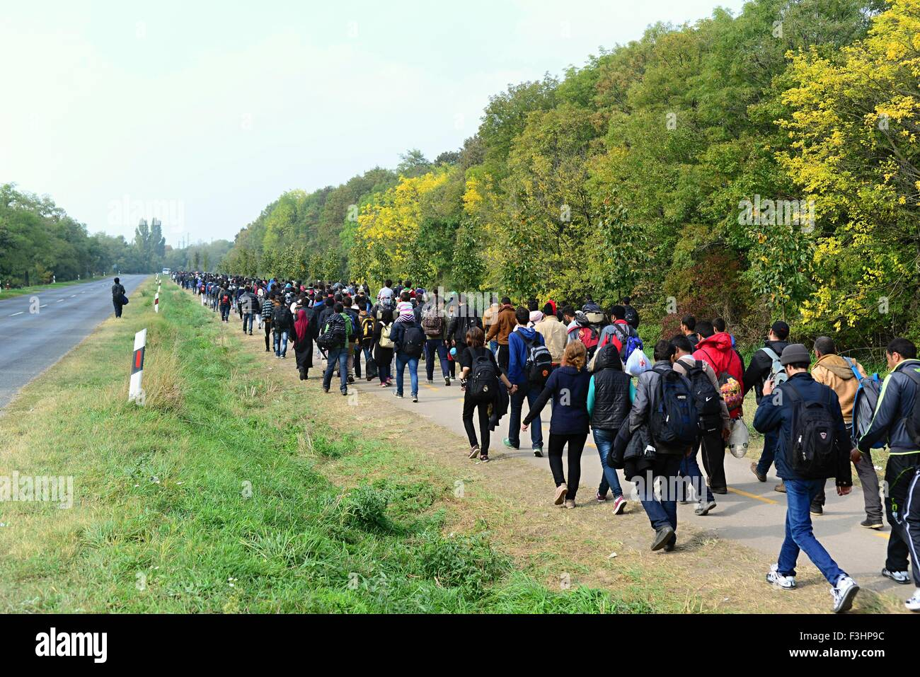 October 6,2015; Hegyeshalom in Hungary. Group of refugees leaving Hungary. They came to Hegyeshalom by train and - Stock Image