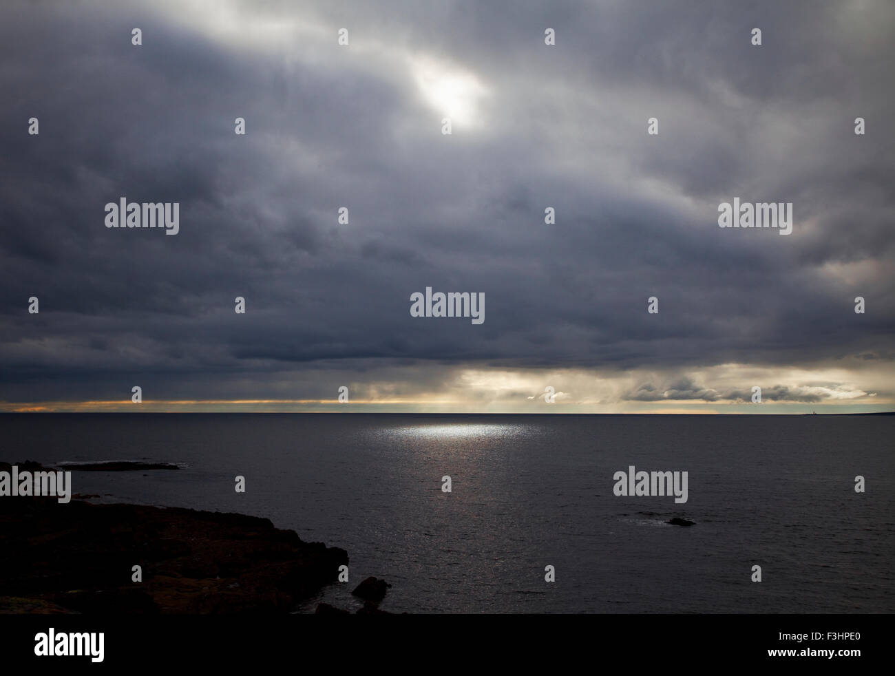 Seascape and sunburst off the Burren Coast, County Clare, Ireland - Stock Image