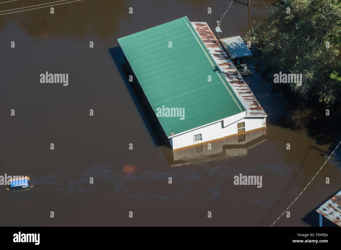 Aerial view of floodwaters submerging a home after record breaking storms dumped more than two feet of rain October - Stock Image
