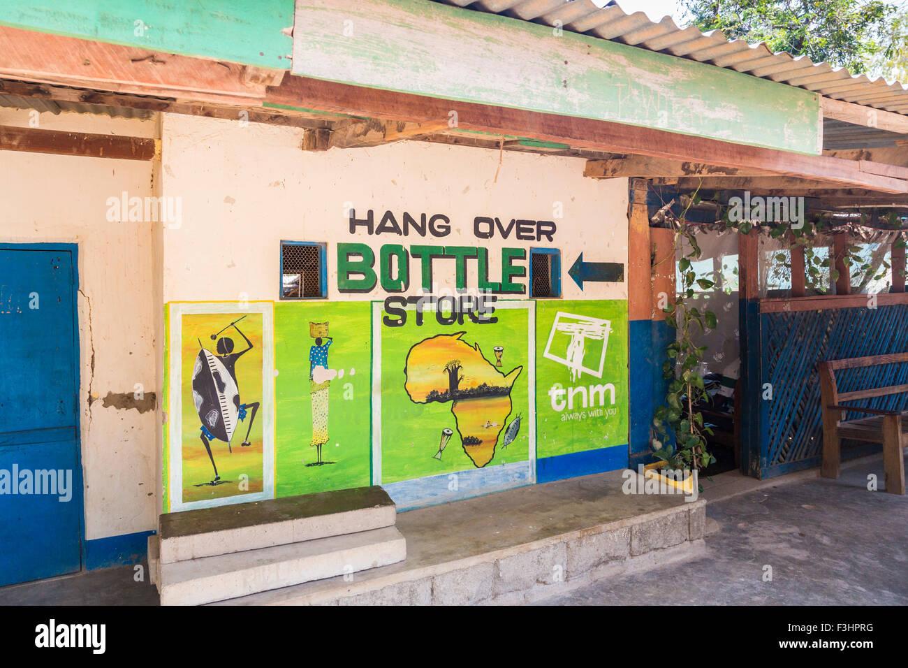 Amusingly named 'Hang Over Bottle Store' bar, cafe and bottle bank, on Likoma Island, Lake Malawi, Malawi, - Stock Image