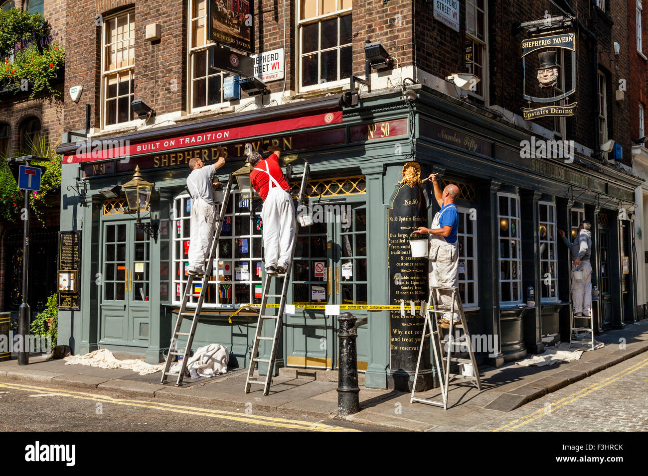 Painters And Decorators Painting A Pub Exterior Shepherd