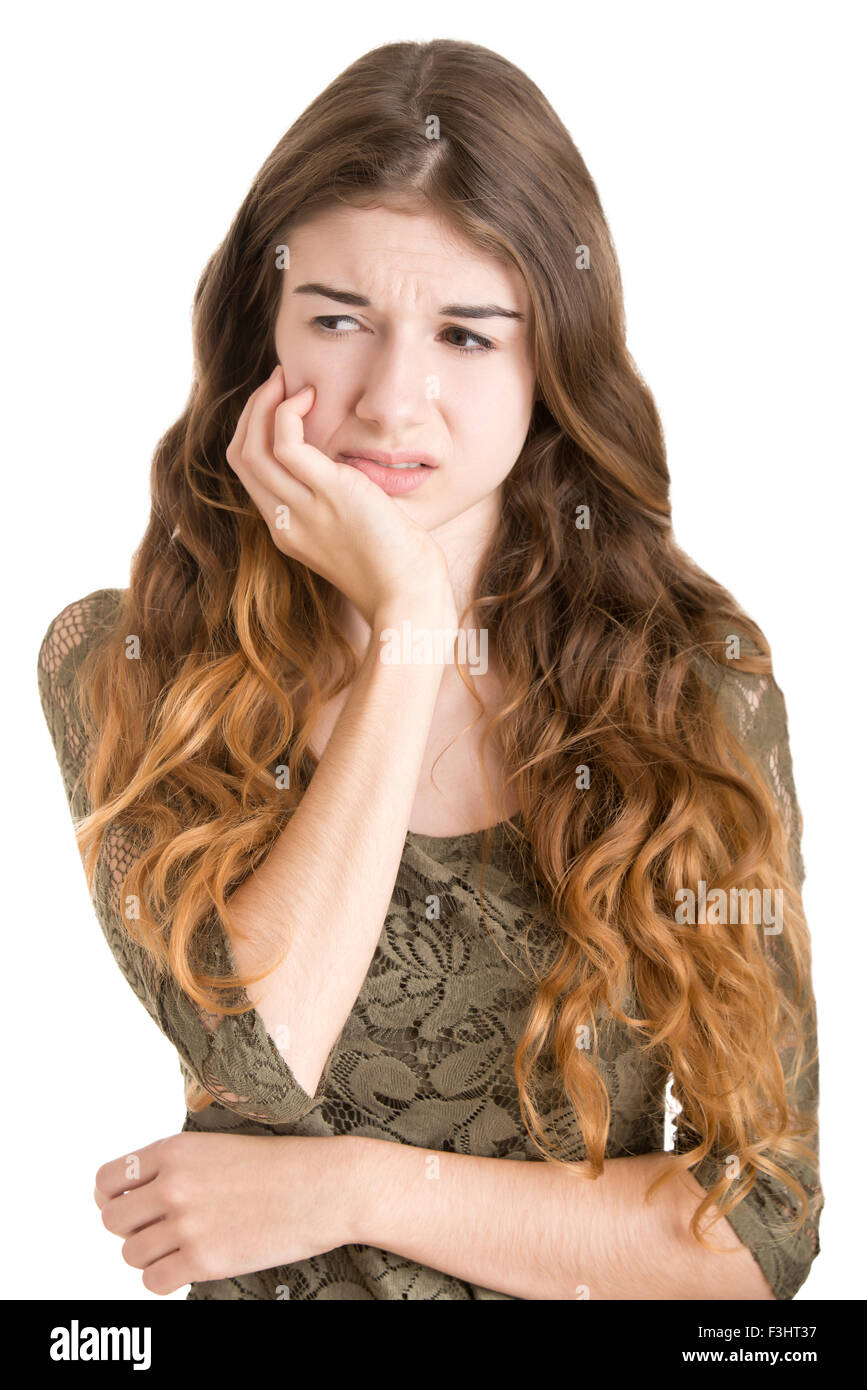 Woman with a tooth ache isolated in white - Stock Image