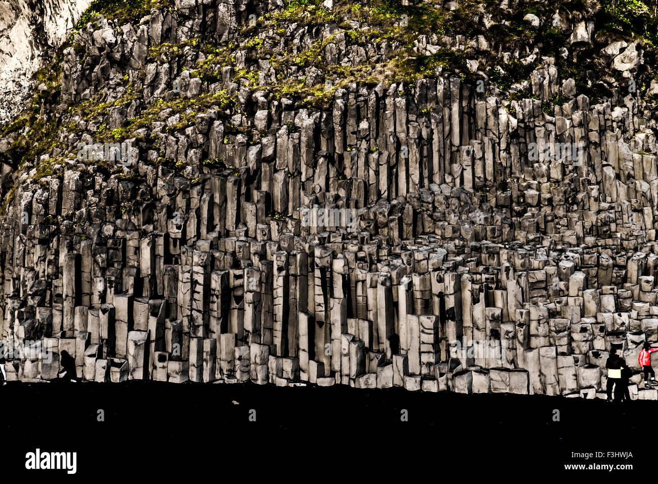 Basalt geometrical column rock formations on the black sand volcanic Kirkjufjara beach near Vik, Iceland Stock Photo