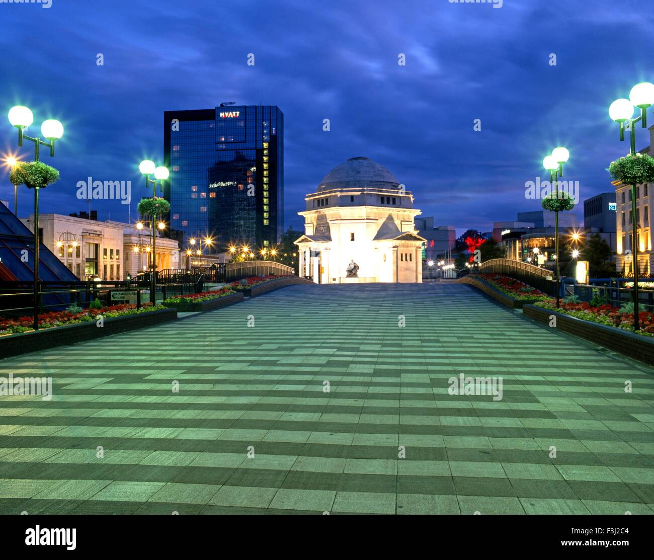 View looking towards the Hall of Memory in the Hyatt Hotel at night, Centenary Square, Birmingham, West Midlands, Stock Photo