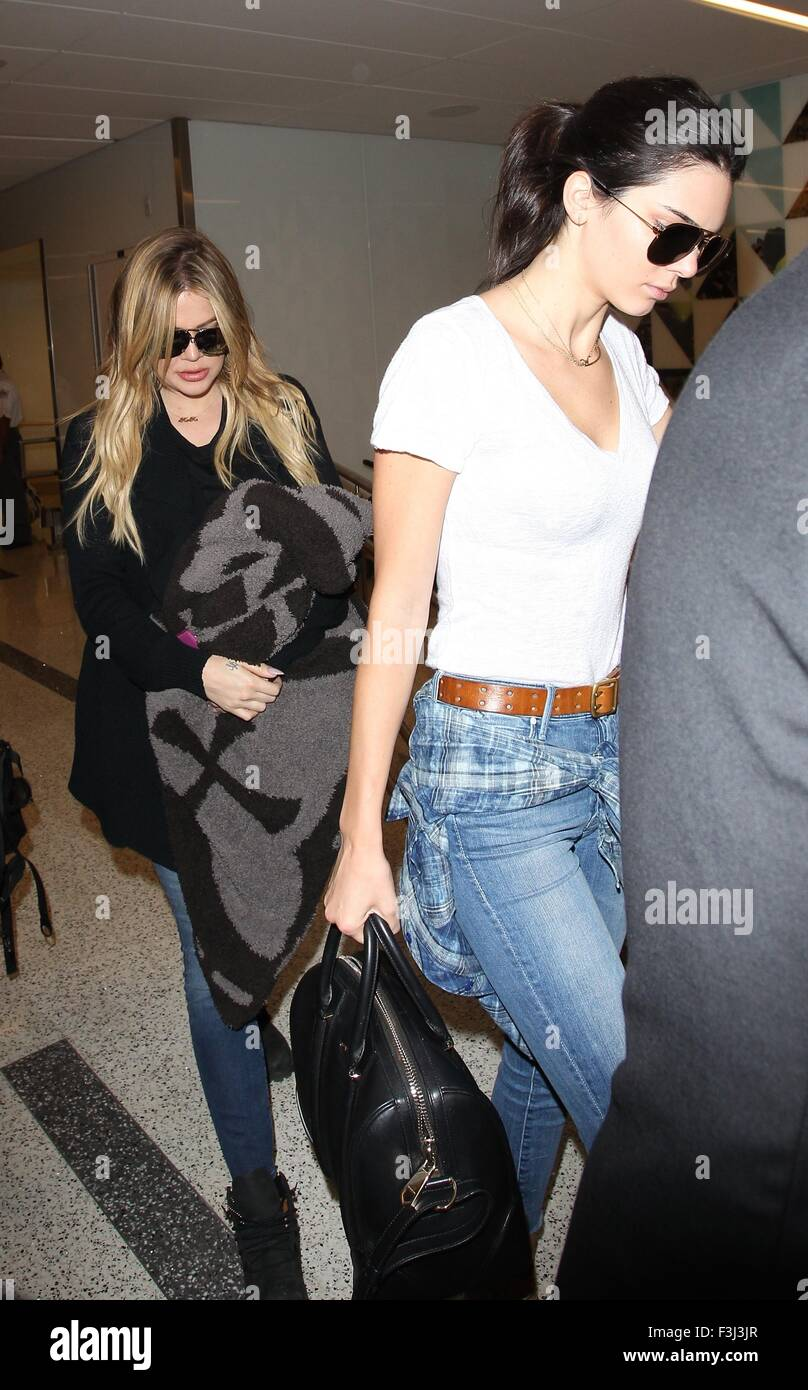 e287a736ec8af4 Khloe Kardashian and Kendall Jenner arrive at Los Angeles International (LAX)  airport Featuring: