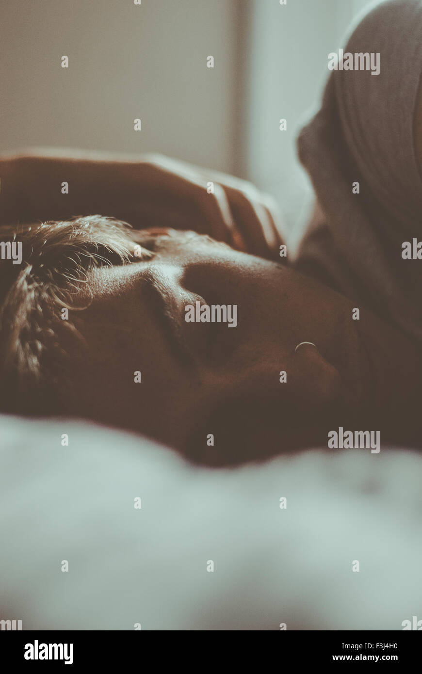 Handsome young man sleeping - Stock Image