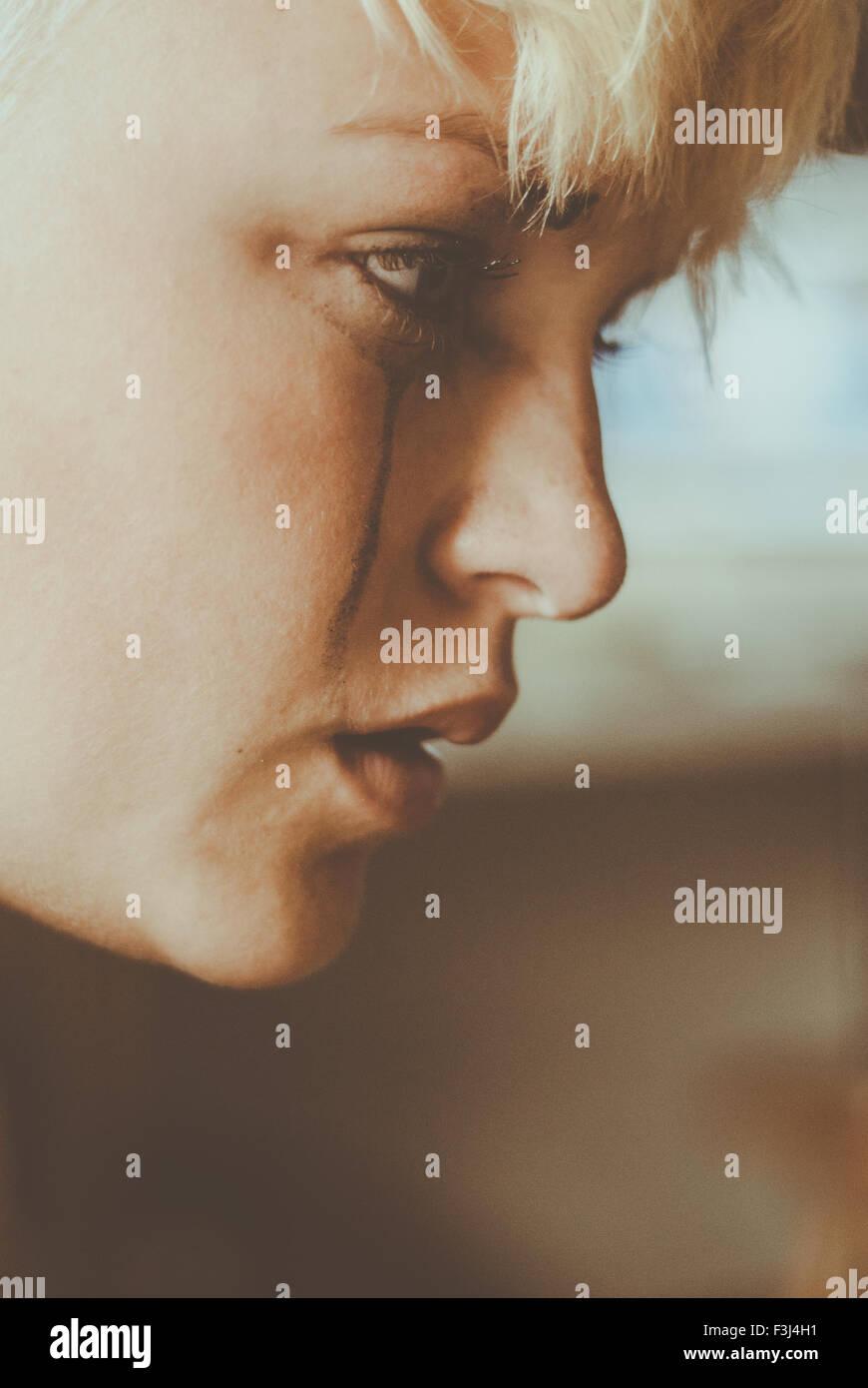 Young teenage girl crying - Stock Image