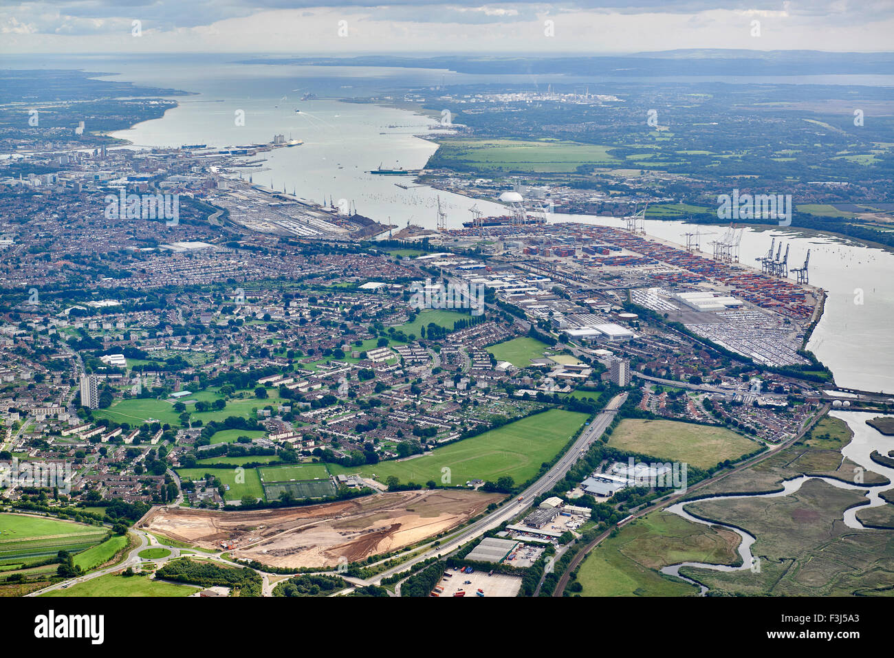 An aerial view of Southampton port and Southampton water, with the Isle of Wight behind, Southern England - Stock Image