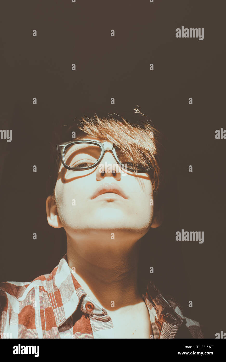 Young hipster girl wearing glasses - Stock Image