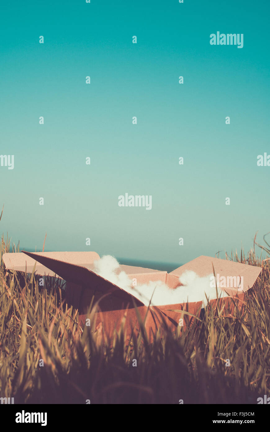 Open box full of clouds by an open blue sky - Stock Image