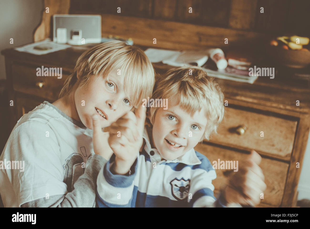 Two little brothers being silly - Stock Image