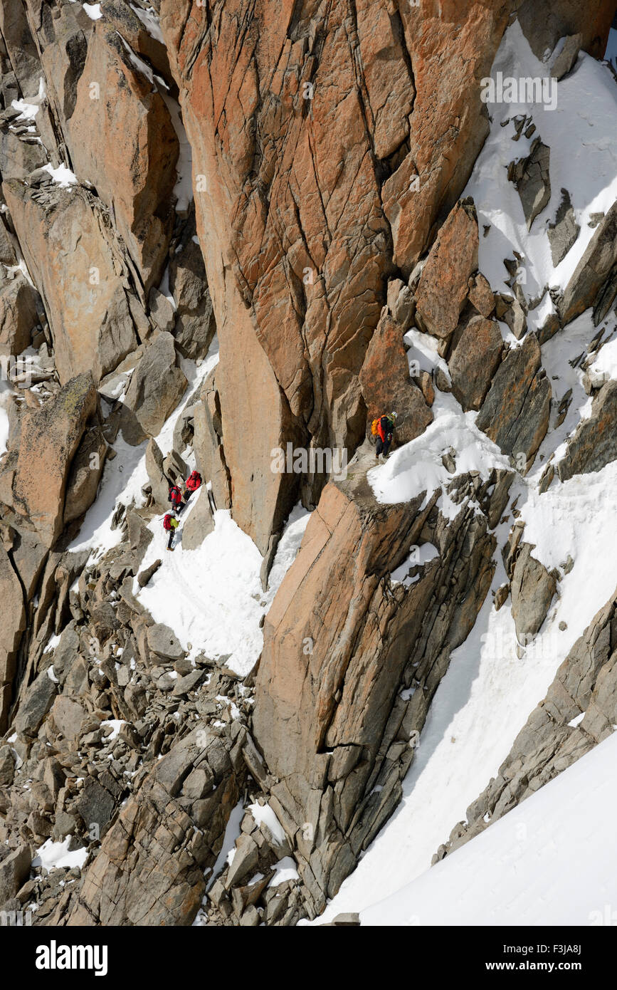 Mountaineers and climbers on a rock face, Aiguille du Midi, Mont Blanc Massif, Chamonix, French Alps, Haute Savoie, Stock Photo
