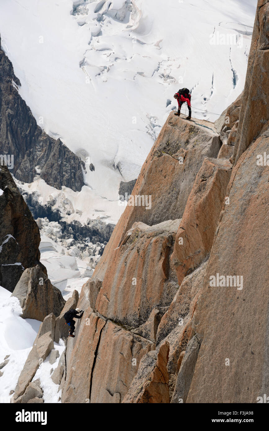 Mountaineers climbing a rock face, Aiguille du Midi, Mont Blanc Massif, Chamonix, French Alps, Haute Savoie, France, Stock Photo