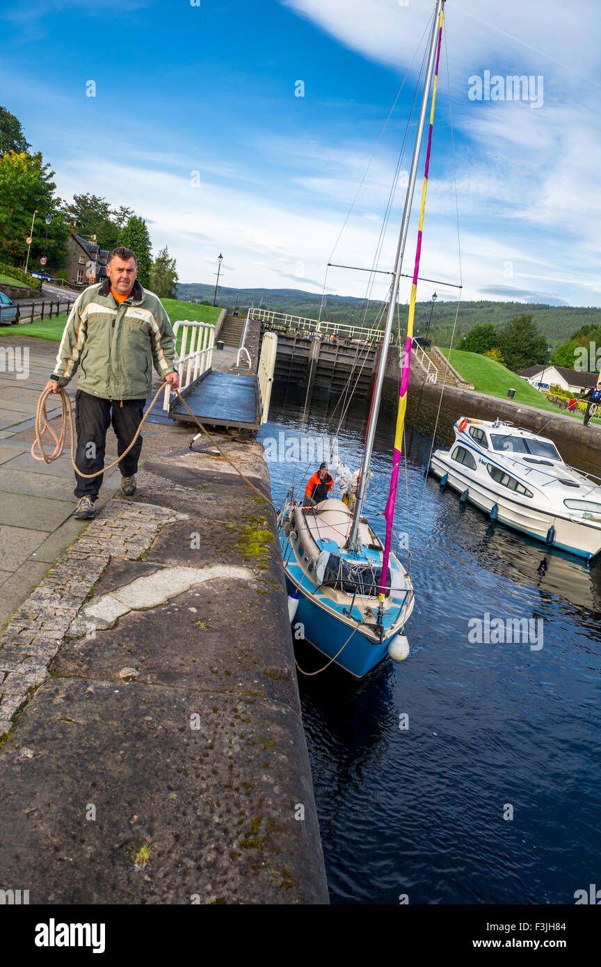 Yachts making their way through the locks at Fort Augustus towards Loch Ness in Scotland. - Stock Image