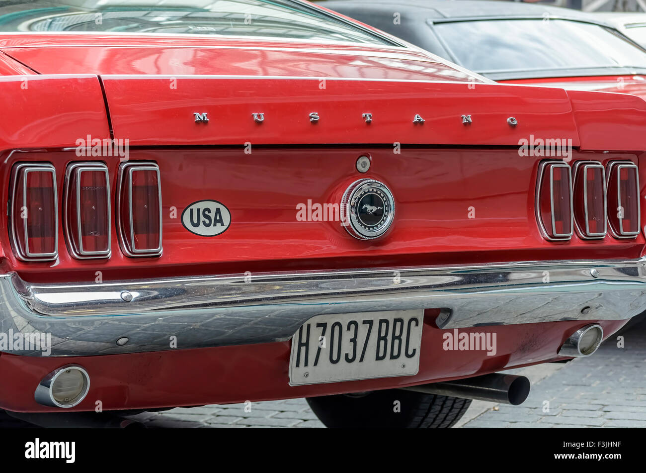 Meeting of classic american cars. Rear view of red car Ford Mustang, of 1967. Stock Photo