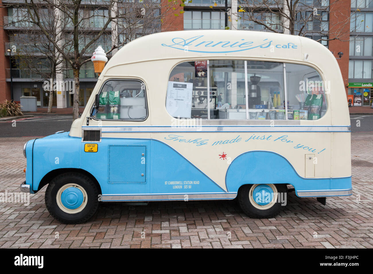 An old ice-cream van converted to a mobile coffee shop in London's Victoria Dock. - Stock Image