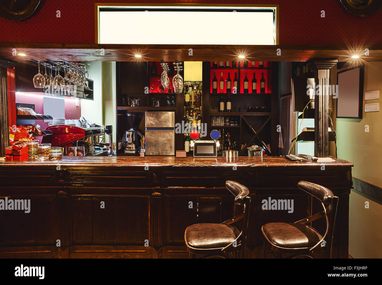 Interior of a modern cafe in retro style, night scene. Illumination, furniture and architectural details. - Stock Image
