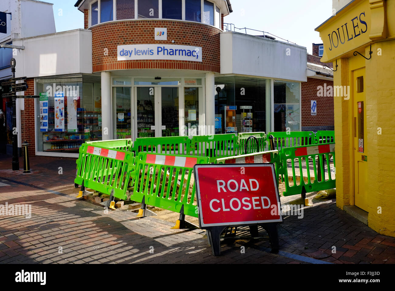 road closed sign shops high street Cowes Isle of Wight UK - Stock Image