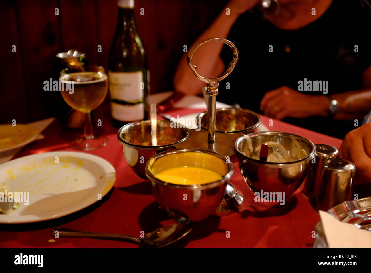 Indian meal starters poppadoms lime pickle onions larger glass plates end of the meal detritus table accutiments restaurant & Indian meal starters poppadoms lime pickle onions larger glass ...