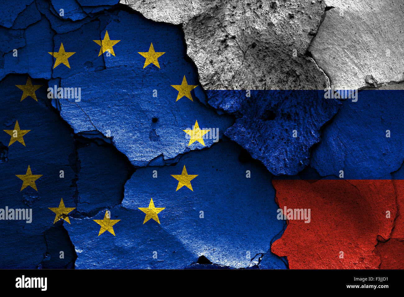 flags of European union and Russia painted on cracked wall - Stock Image