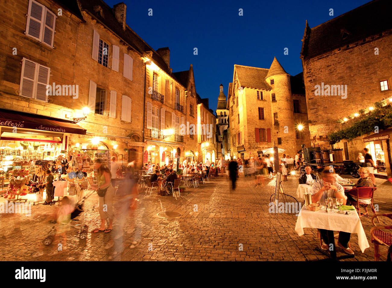 The busy medieval town of Sarlat by night, Dordogne, France. - Stock Image