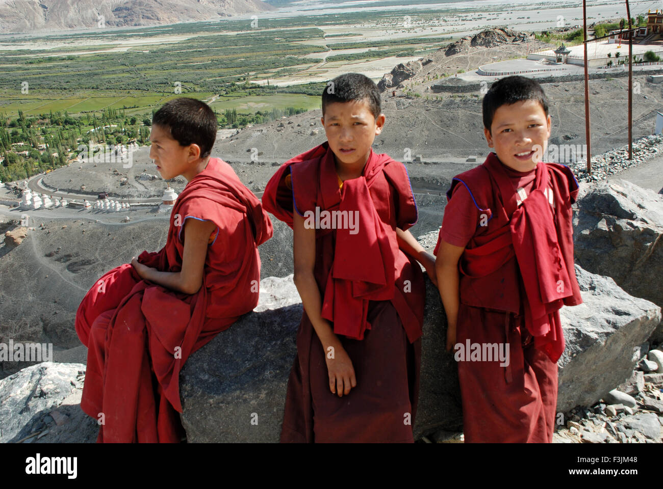 Three young Lama children at Diskit Monastery at Ladakh ; Jammu & Kashmir ; India - Stock Image