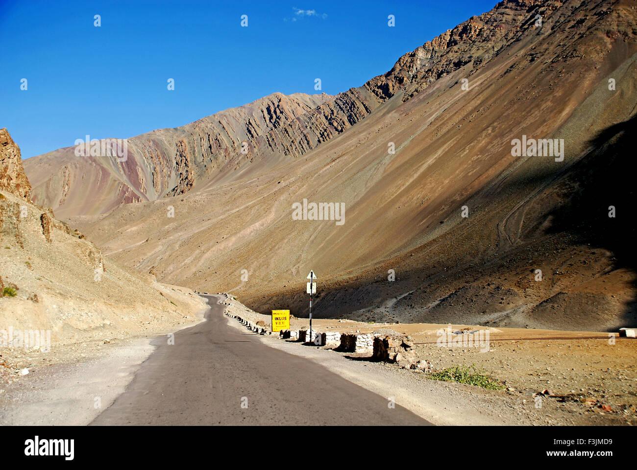 A way among the brown desert mountains ; Ladakh ; Jammu & Kashmir ; India - Stock Image