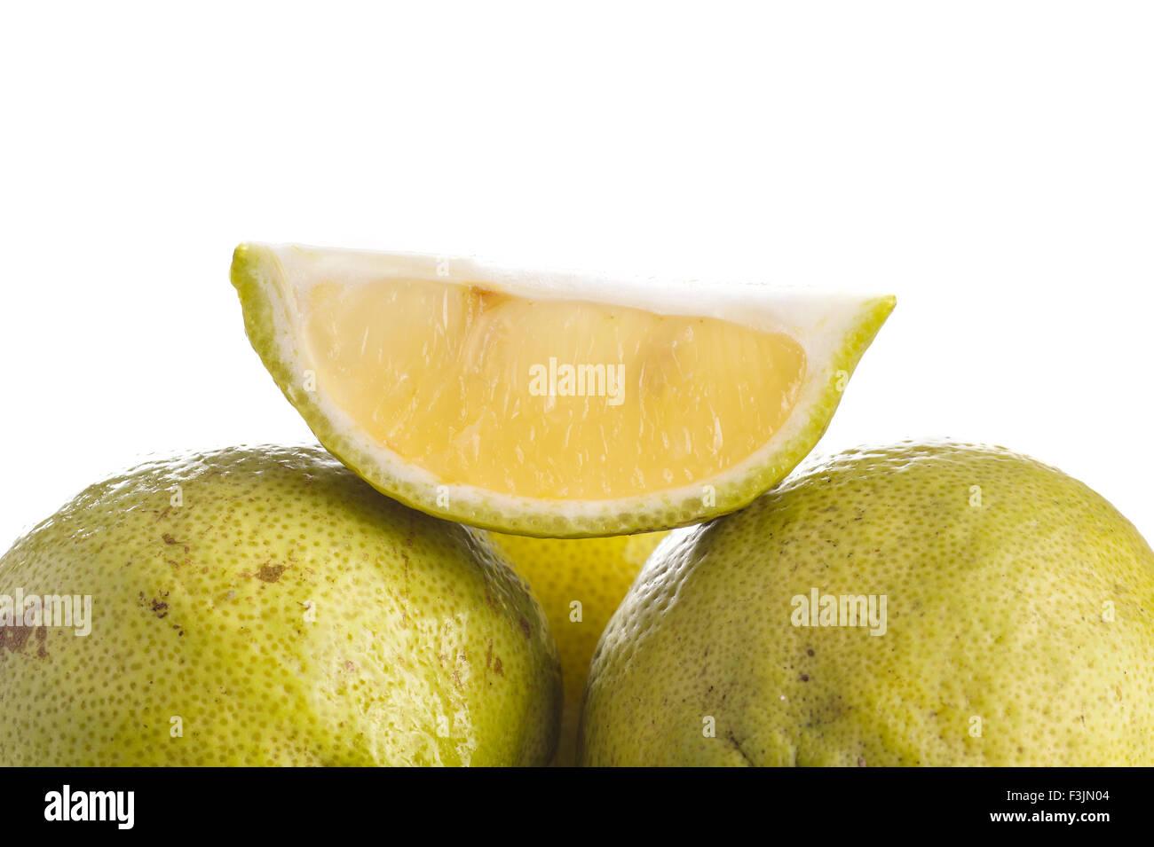 Slice of Green Lemon, isolated on white - Stock Image
