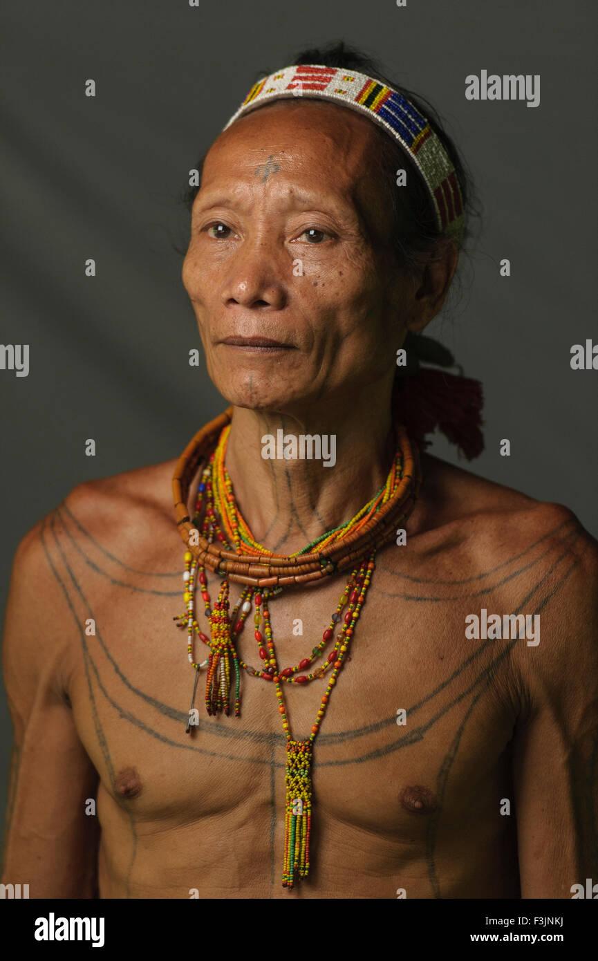 A portrait of Solomon, 57, The indigenous inhabitants ethnic of the islands in Muara Siberut. - Stock Image
