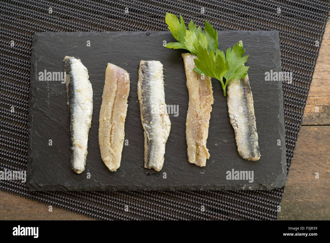 anchovies; parsley; olive oil - Stock Image