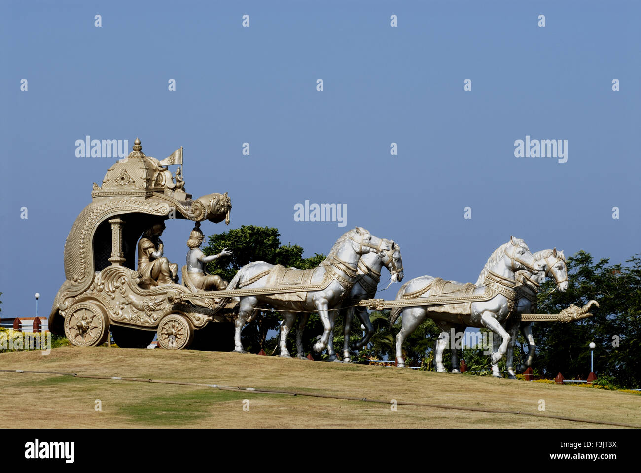 Lord Krishna Bhagavad Gita Arjuna riding horse chariot statues hillock Kandukagiri Murudeshwar Uttar Kannada karnataka - Stock Image