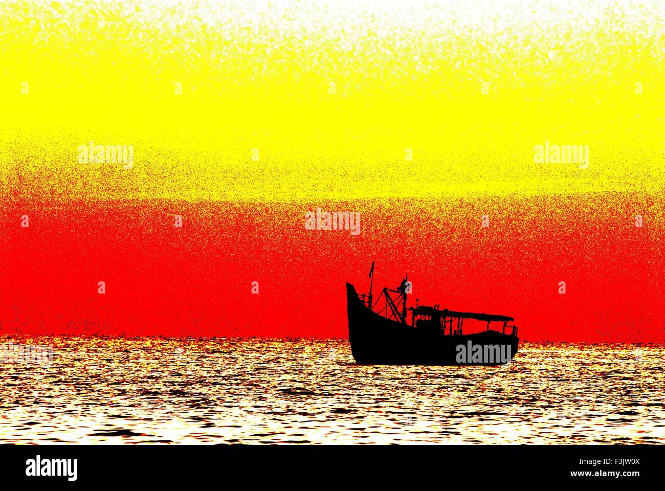 Fishing Activity Colorful Sunset with one country fishing boat at Malpe Beach Silhouette Arabian sea Udupi karnataka - Stock Image