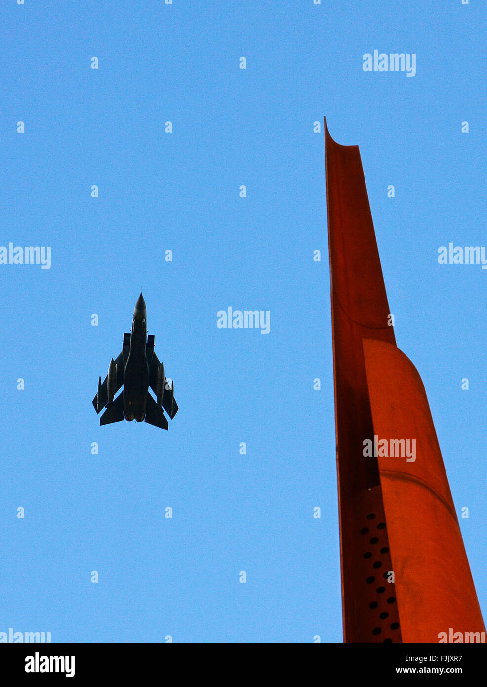 A Tornado overflight by 'MacRobert's Reply' at The International Bomber Command Centre's Memorial - Stock Image