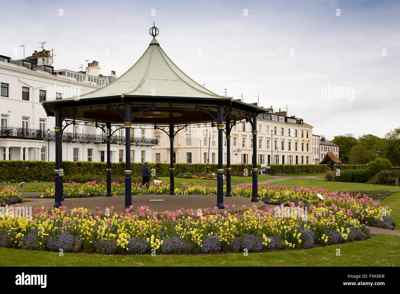 UK, England, Yorkshire East Riding, Filey, Crescent Garden, bandstand and floral planting below seafront houses - Stock Image