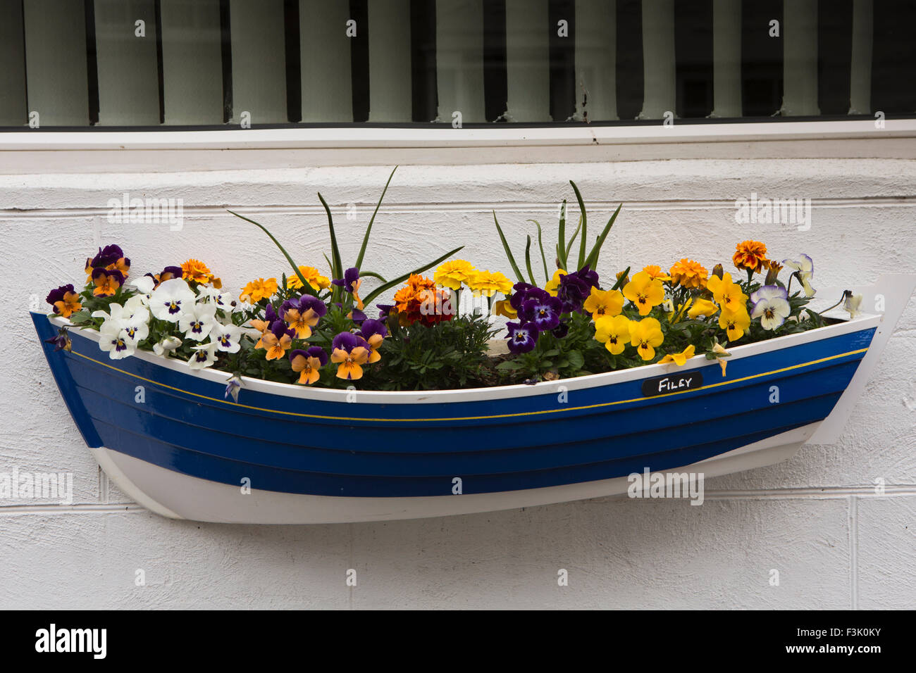 UK, England, Yorkshire East Riding, Filey, Queen Street, boat shaped window box planter - Stock Image