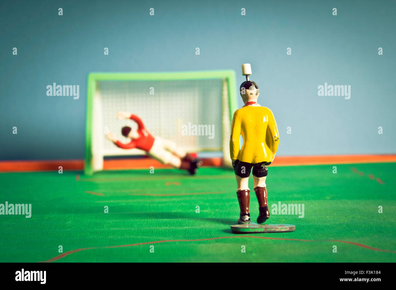 tip kick vintage game of football - Stock Image