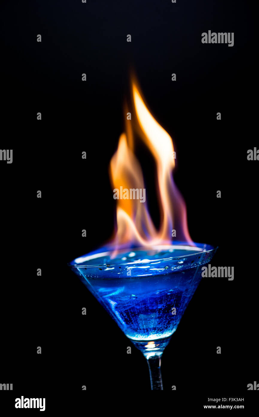 Fire blowing out of blue lagoon glass close-up with black background and  laser 310c0b101eba