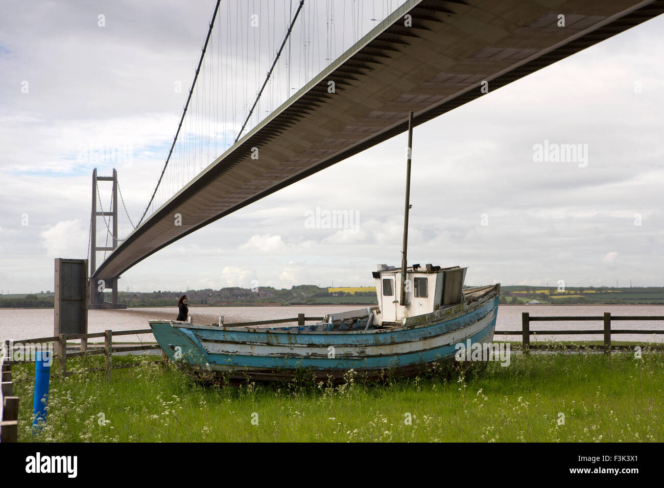UK, England, Yorkshire East Riding, Hessle, old fishing boat below Humber Suspension Bridge Stock Photo